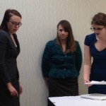 Seniors Myra Milam and Kristen Wright help Senior Maddie Ebert prepare for Finals in Lincoln-Douglas Debate.